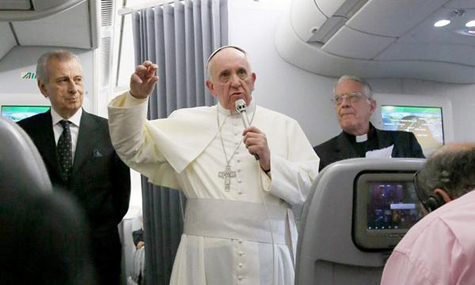 Pope Francis holding a press conference aboard the plane en route back to the Vatican from South Korea, August 18, 2014.