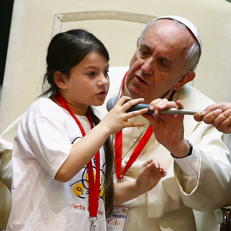 Pope Francis receiving a statement or question from a little girl from the Children's Train, at the Vatican, May 30th, 2015.