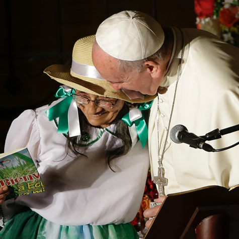 Pope Francis embracing Imelda Caicedo, a delegate of the Ecuadorian coastal farmers association, after she delivered a speech during his visit to the Church of St. Francis in Quito, Ecuador, July 7, 2015.