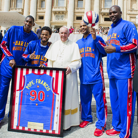 Pope Francis receiving a jersey to be an honorary member of the Harlem Globetrotters, at St. Peter's Square, May 6th, 2015.